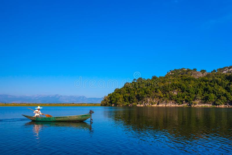 A fisherman`s boat with a motor on Lake Skadar. Montenegro. royalty free stock photography