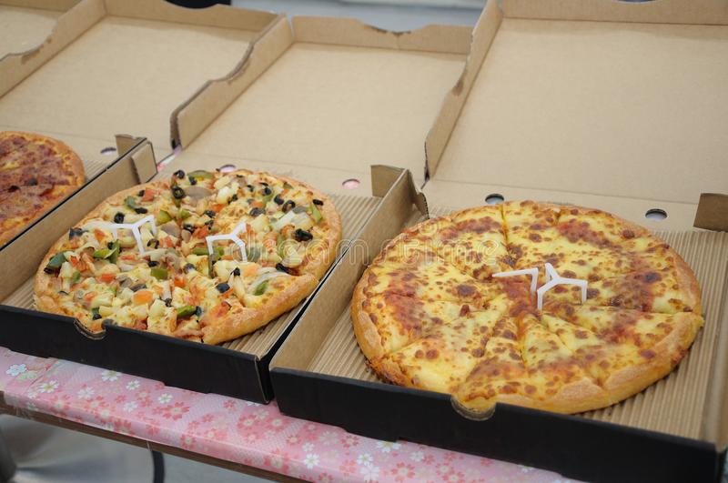 Some pizzas in the boxes ready for serving. A photo taken on some pizzas in the boxes ready for serving stock images