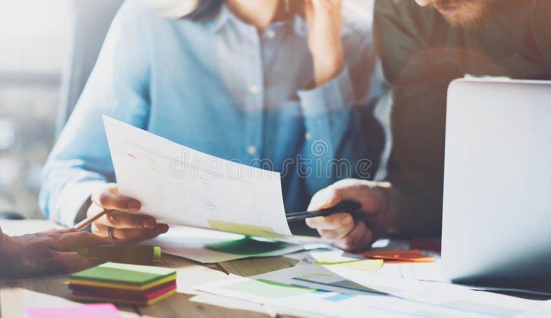 Photo team work process, signs contracts table. Account managers young crew works with startup project.New idea stock images
