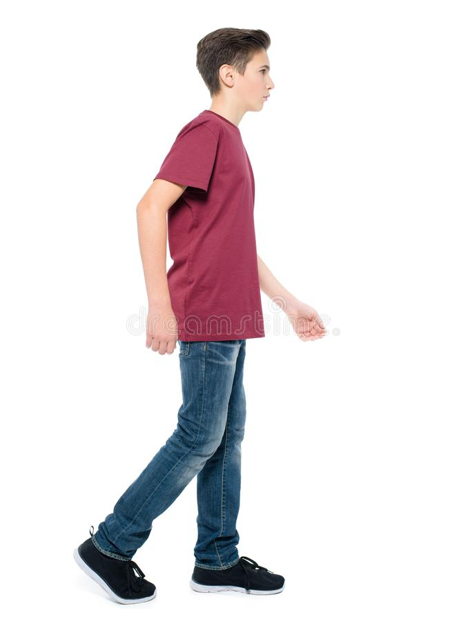 Teen boy walking - posing at studio royalty free stock photo