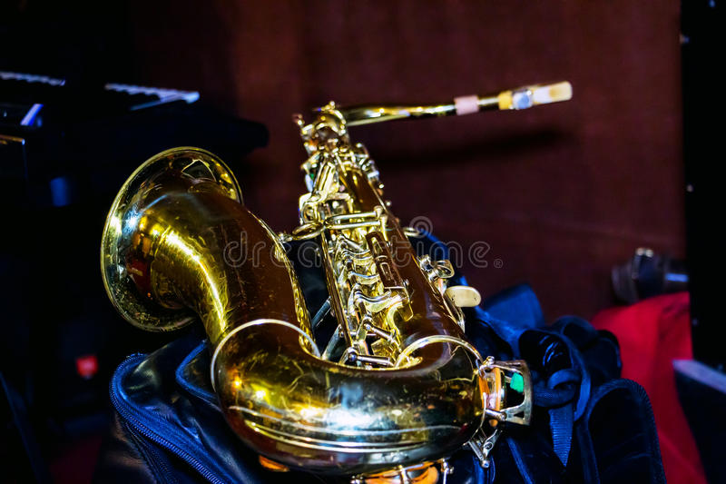 Photo tenor sax. Golden color. The saxophone is in the rehearsal room royalty free stock photography
