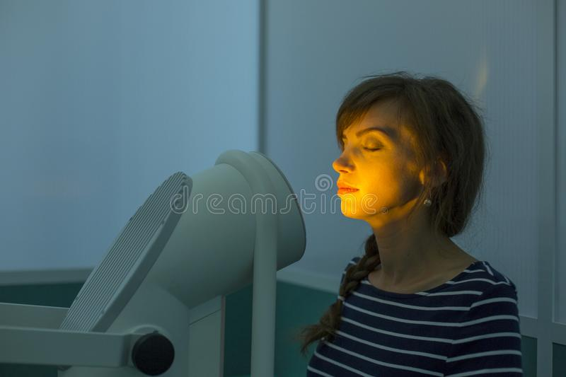 Photo therapy. The clinic procedure which makes your skin more shiny, smooth and clean. Photo therapy. The clinic procedure for skin royalty free stock images