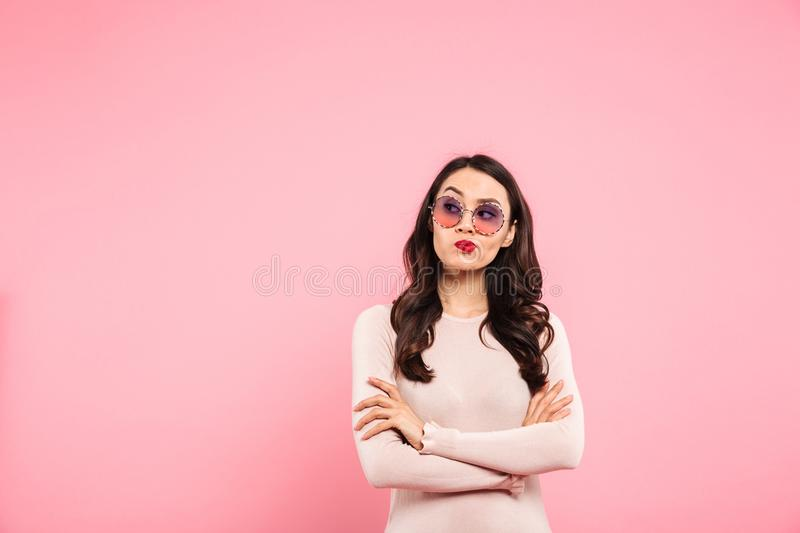 Photo of thoughtful adult girl with red lips wearing trendy sung stock images