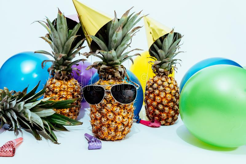 Photo Of Three Pineapples Surrounded By Balloons stock photography