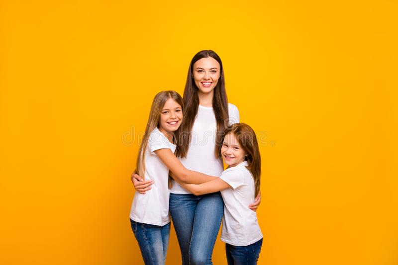 Photo of three sister ladies glad to be together at weekend wear casual outfit isolated yellow background royalty free stock photography