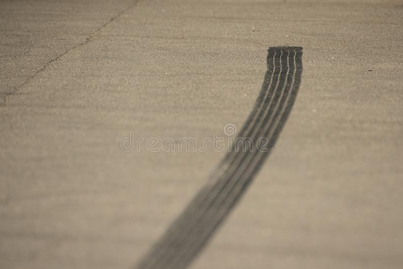 Photo of a tire skid mark. Race car royalty free stock image