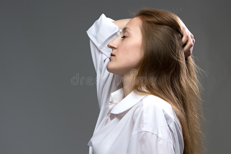 Photo of tired woman with closed eyes stock image