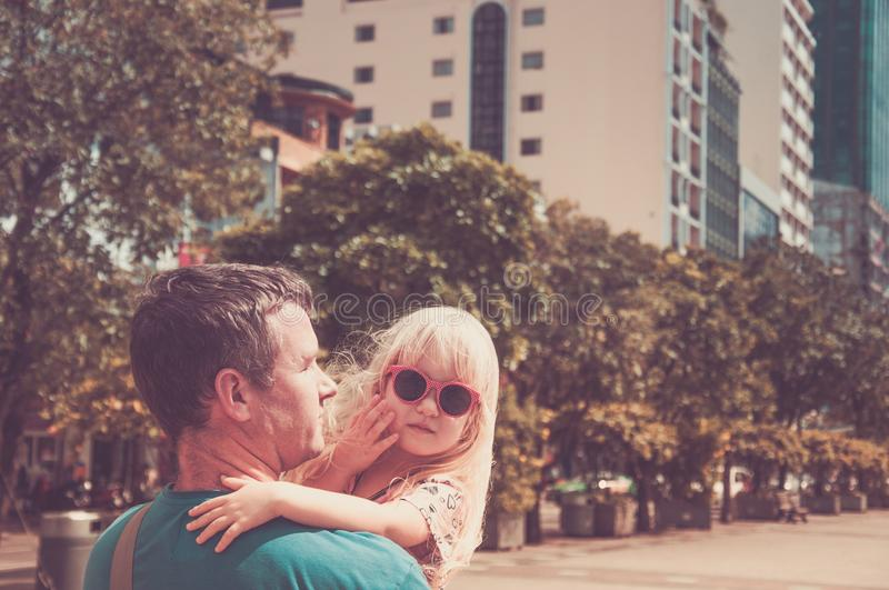 Photo toned in retro style. Little cute blond girl in sunglasses stock images