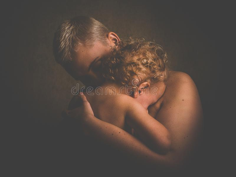 Photo of Topless Person Carrying Curly Haired Child royalty free stock photography