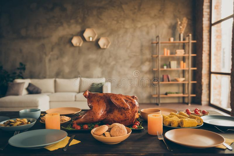 Photo of traditional thanksgiving dinner meal with roasted turkey corn harvest cranberry pie tomato potato plates forks. Photo of traditional thanksgiving dinner stock image