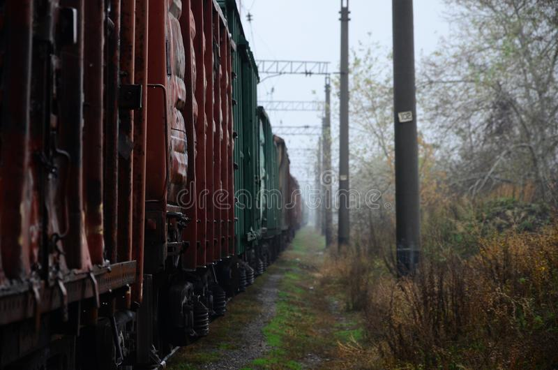 Photo of the train on rainy cloudy weather with shallow depth of fiel. D royalty free stock image