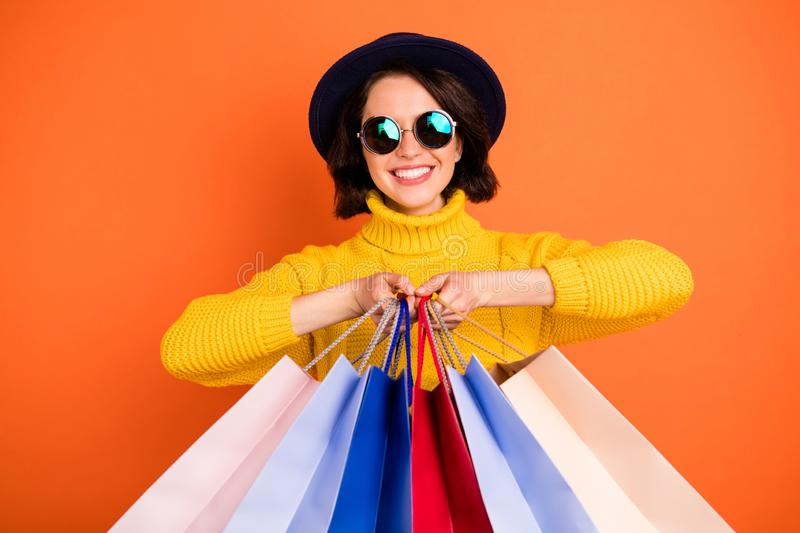 Photo of trendy charming excited nice good girlfriend wearing cap holding bags with something newly bought while stock images