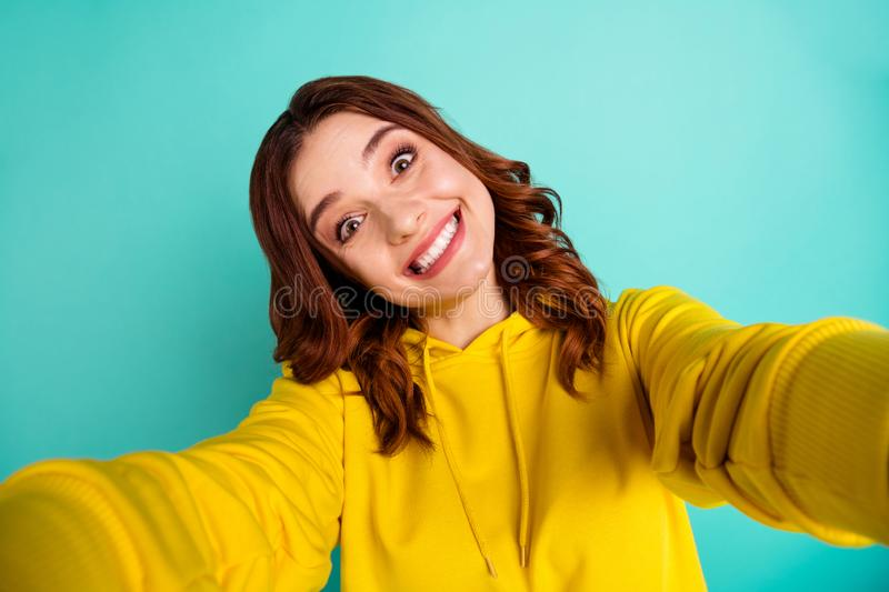 Photo of trendy cute cheerful nice millennial smiling toothily showing teeth with face expression of joyfulness while royalty free stock photo