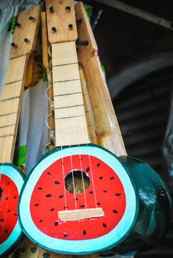 Photo of a tropical ukelele guitar in watermelon design. royalty free stock photo