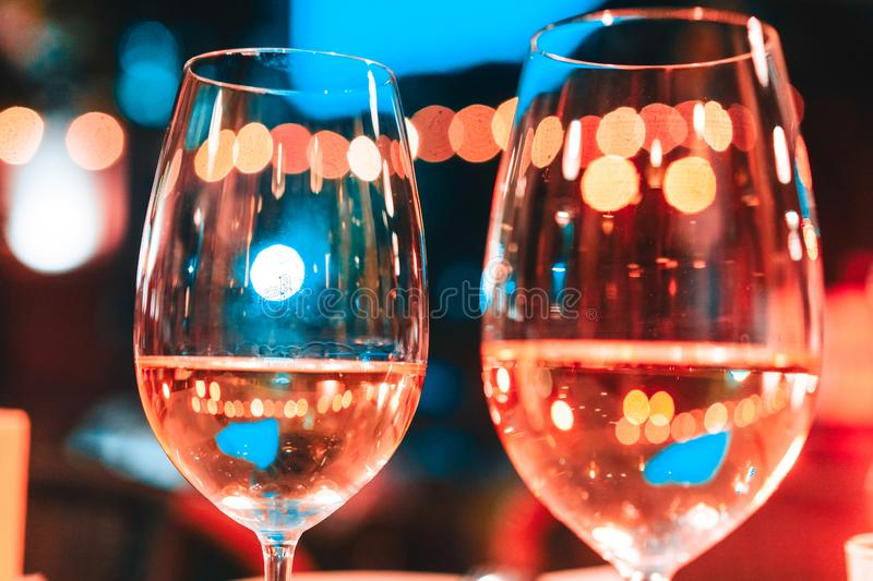 Photo of two champagner glasses on table. With bokeh background stock image