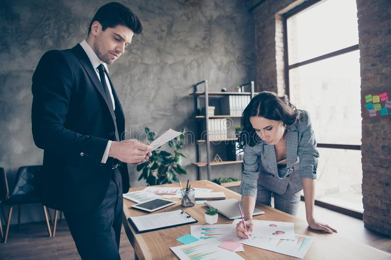 Photo of two colleagues learning secretary report standing workshop office dressed formal wear suits royalty free stock image