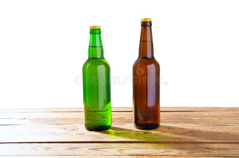 Photo of two different full beer bottles with no labels. Separate clipping path for each bottle included.2 two separate photos stock image