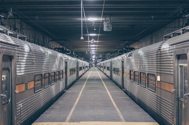 Photo Of Two Grey Trains In Station royalty free stock photography
