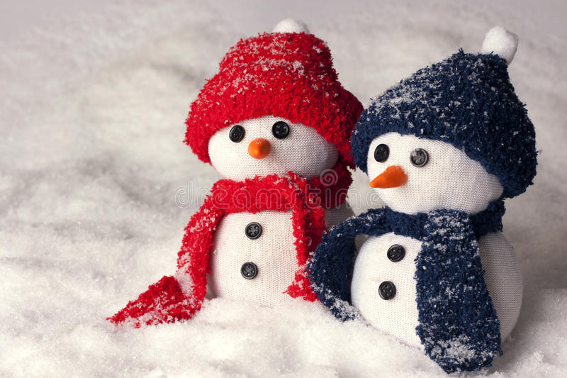Photo of two hand made snowman in blue and red color. Photo of three hand made snowman in blue color and red - optimal decoration for christmas, new year, winter stock photos