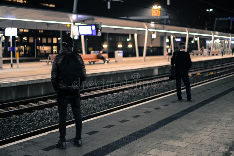 Photo of Two Men Standing Near Railway Station royalty free stock images