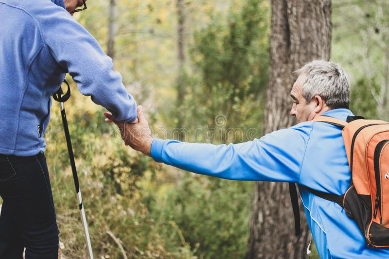 Photo of Two Old Man Helping Each Other royalty free stock photos