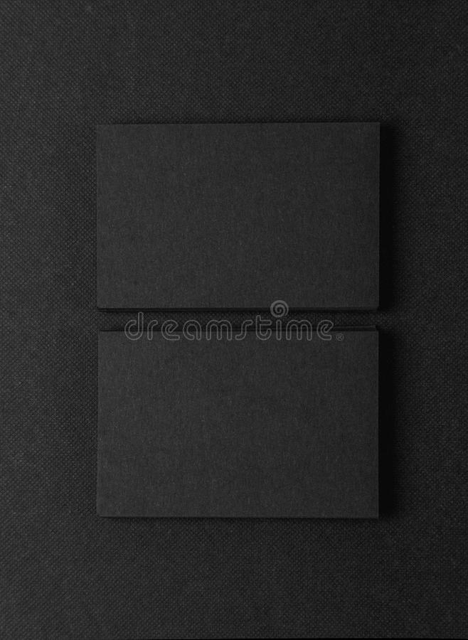 Photo of two stack Of blank black business cards on textile background. Vertical royalty free stock photos