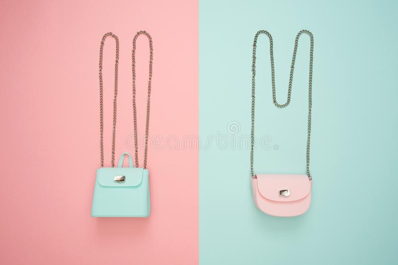 Photo of Two Teal and Pink Leather Crossbody Bags royalty free stock photo