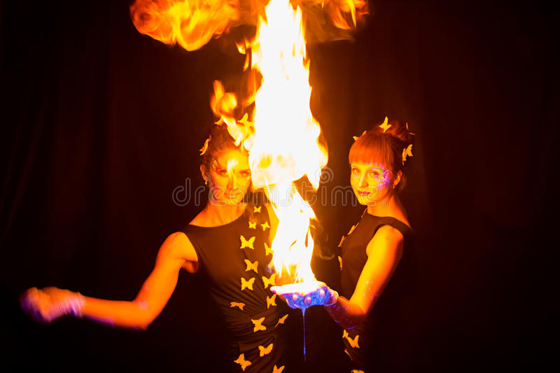 Photo of two woman with luminous make up and fire stock images