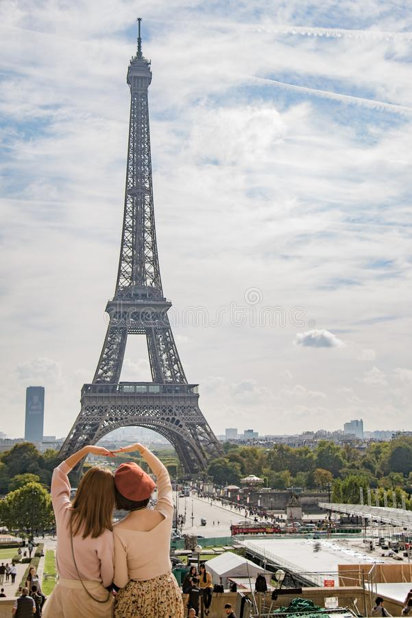 Photo of Two Women Posing in Front of Eiffel Tower, Paris, France during Day Time stock photos