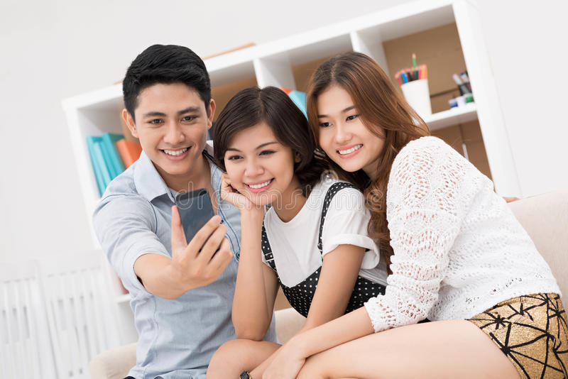 Photo of us. Image of youngsters making photo of themselves at home royalty free stock photos