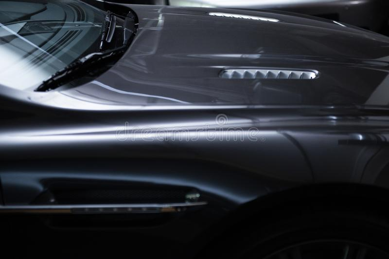 Back view of a modern luxury gray  metallic car, auto detail, car care concept in the garage. This photo about view of a modern luxury gray car, auto detail, car stock photo