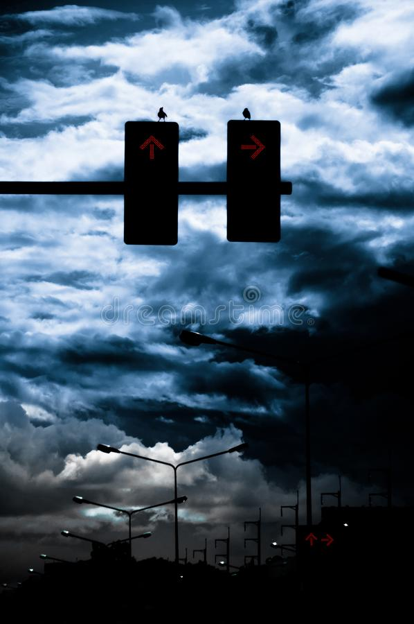 View the scary clouds with traffic lights royalty free stock photo