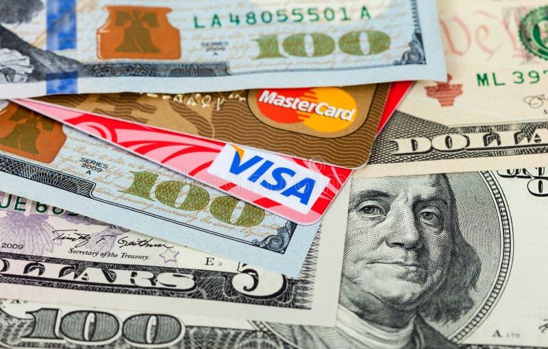 Photo of VISA and Mastercard credit card with american dollars royalty free stock image