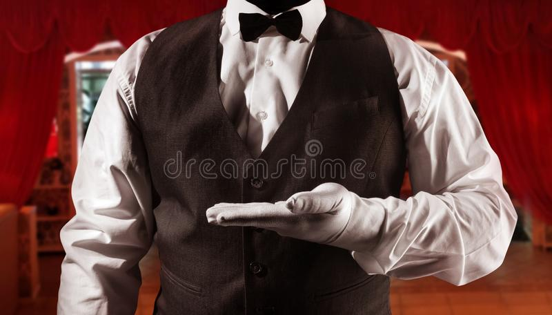 Waiter showing hand copyspace royalty free stock image
