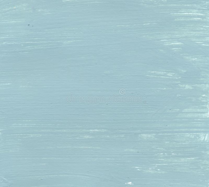 A blue green paint texture made with acryl. A photo of a wall texture made with green acrylic paint royalty free stock photo