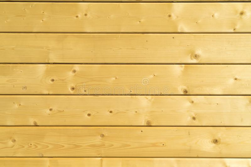 Photo wall of a wooden house made of wooden beams. stock photo