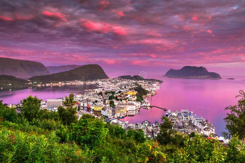 Pink Dawn in Alesund, the most beautiful town in the western coast of Norway. The photo was taken from Aksla viewpoint at a breaking dawn in Alesund, More og stock image