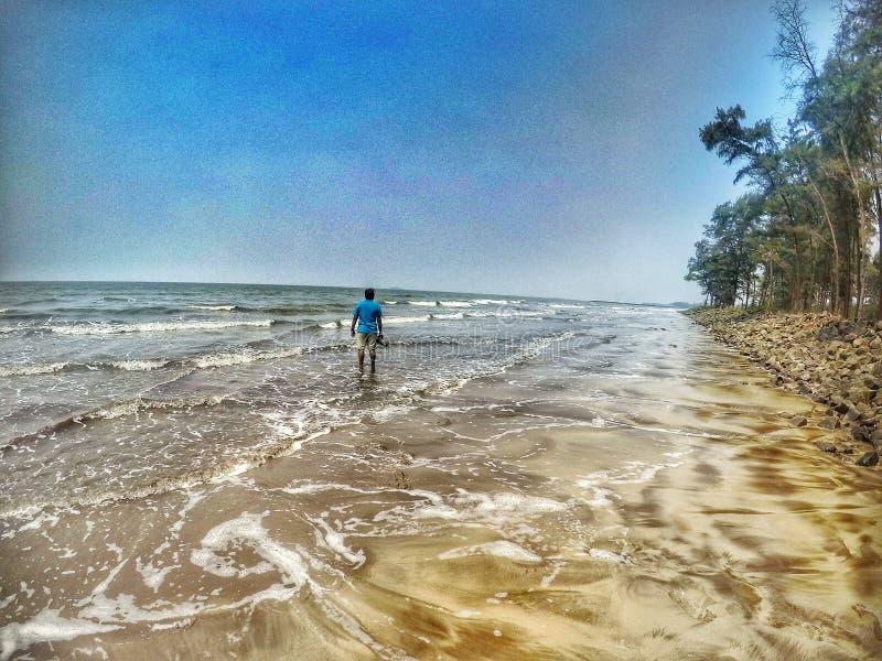 Walk alone on Seashore stock images