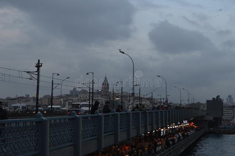Turkey Istanbul - January 6, 2018: fishermen on the Galata bridge stock photography