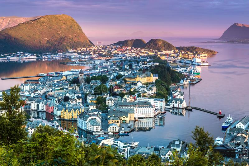 City Scene with Aerial View of Alesund Center in The Early Morning Sunshine. Image of Alesund in the early morning sunlight in Summer taken from Mount Aksla stock images