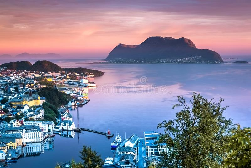 Gorgeous sunrise in Alesund, More og Romsdal County, Norway. This photo was taken from Mount Aksla viewpoint at a breaking dawn in Summer. After waiting alone stock image