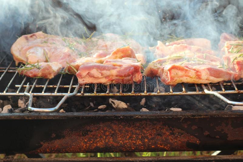 The meat is on the barbeque. This photo was taken in Caniparola, Tuscany in Italy on a warm summer day royalty free stock images