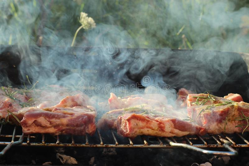 The meat is on the barbeque. This photo was taken in Caniparola, Tuscany in Italy on a warm summer day royalty free stock photo