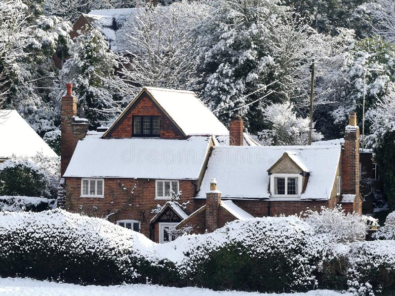 Constables Cottage, Dog Kennel Lane, Chorleywood in winter snow. This photo was taken in Chorleywood, Hertfordshire, England, United Kingdom in the month of stock photo
