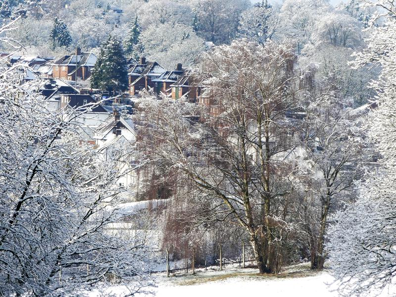 Winter snow scene on Chorleywood Common with village houses in distance. This photo was taken in Chorleywood, Hertfordshire, England, United Kingdom in the month royalty free stock image