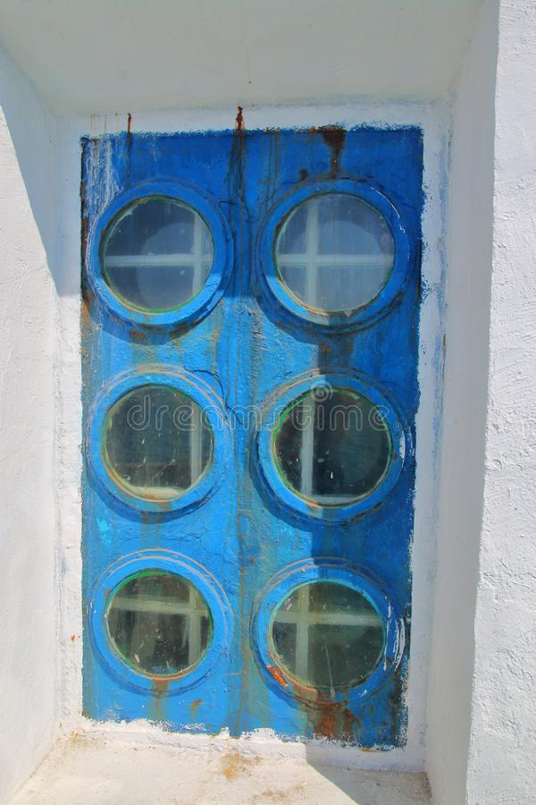 Unusual window of an old lighthouse stock photography