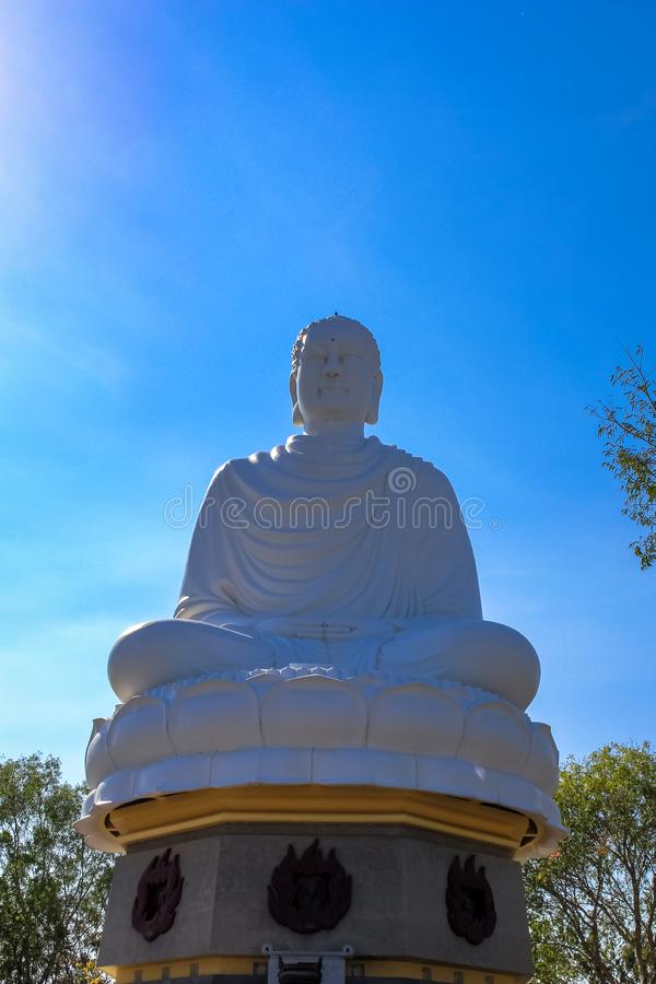 A Huge White Sitting Budha Statue against Blue Sky royalty free stock photos