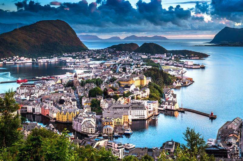 City Scene with Aerial View of Alesund Center after Sunset. Image of Alesund after sunset in Summer taken from Mount Aksla Viewpoint. Alesund is a port town on royalty free stock photos