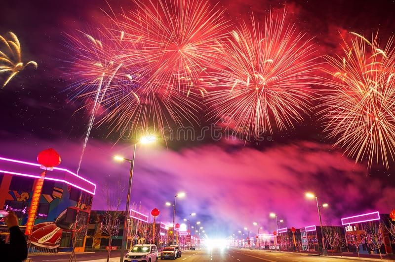 The beautiful fireworks reach on the Motor city. The photo was taken in Motor City of Daqing city,Heilongjiang province, China.It was setting off fireworks to stock images