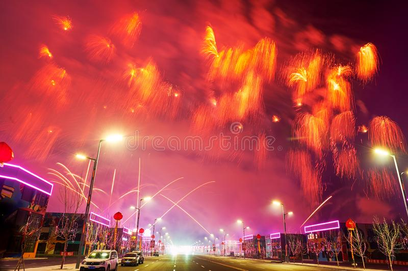 The beautiful fireworks reach on the Motor city in Lantern Festival. The photo was taken in Motor City of Daqing city,Heilongjiang province, China.It was setting stock photo